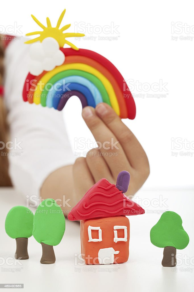 Clean environment concept - child hand with colorful clay figure stock photo