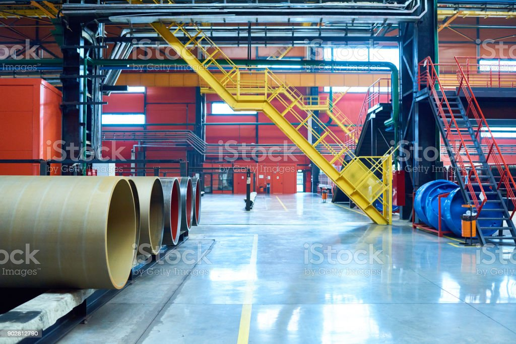 Colorful factory workshop with shining floor and bright ladders where...