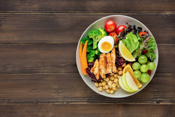 clean food with mixed vegetable and fruit salad on wood table background - sodium stock pictures, royalty-free photos & images
