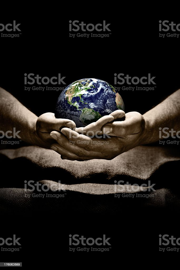 \'Clean hands carefully holding globe in spotlight. Conseptual image:...