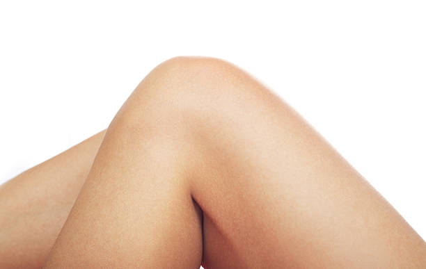 Clean human knee on a white background  Close-up photo of the human knee on a white background bending stock pictures, royalty-free photos & images