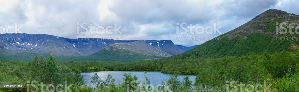 Clean lake at the foot of the Khibiny mountains, Kola Peninsula, Russia. stock photo