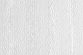 istock Clean light white lined paper texture on macro. High resolution photo. 1165673312