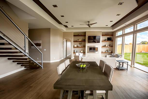 clean modern comfortable new home interior kitchen and dining room - küche neu gestalten ideen stock-fotos und bilder