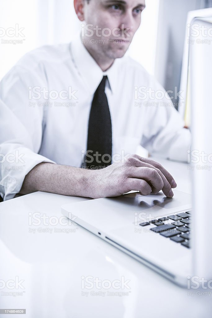 Clean Modern Office and Focused Business Man royalty-free stock photo