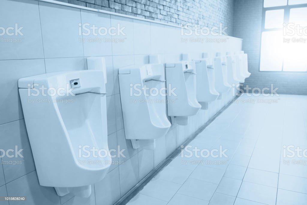 clean new men bathroom blue color tone stock photo