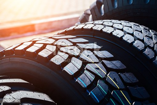 istock Clean new modern truck tire. Close up view of surface 942007364