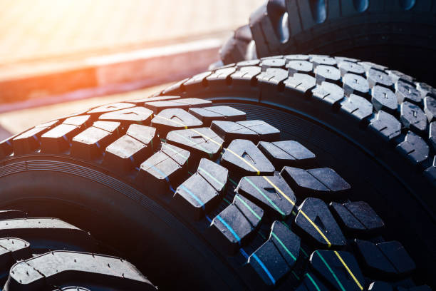 clean new modern truck tire. close up view of surface - truck tire foto e immagini stock