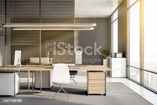 istock Clean office interior with equipment, furniture, sunlight, window with city view and concrete flooring. Worplace and workspace concept. 3D Rendering. 1347759795
