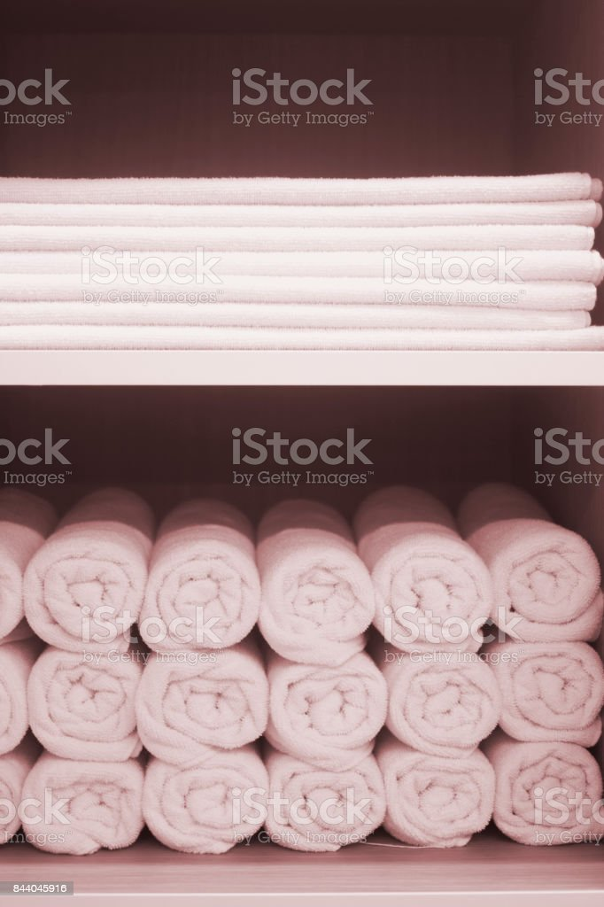 Clean pressed towels in luxury hotel health club spa resort for guests to dry stock photo