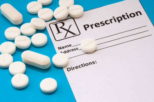 Clean recipe for prescription drug statement is near scattered white pills and tablets on a blue background. Pharmacological or medical concept photo to refer to prescription medicines for patients Clean recipe for prescription drug statement is near scattered white pills and tablets on a blue background. Pharmacological or medical concept photo to refer to prescription medicines for patients opioid stock pictures, royalty-free photos & images