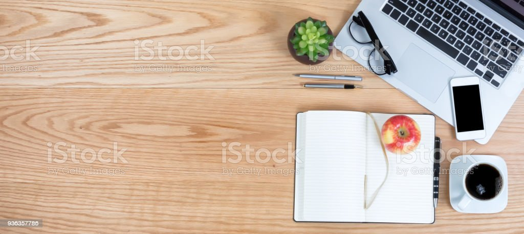 Clean red oak desktop with apple fruit and coffee for business or education background stock photo