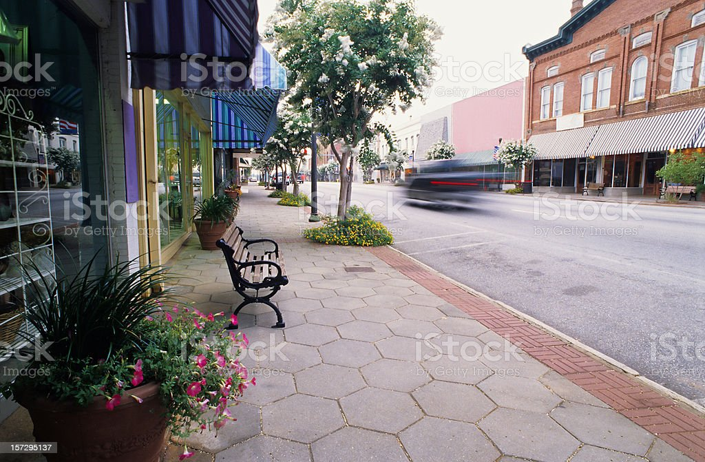 Clean road with bench in Americus, Georgia royalty-free stock photo