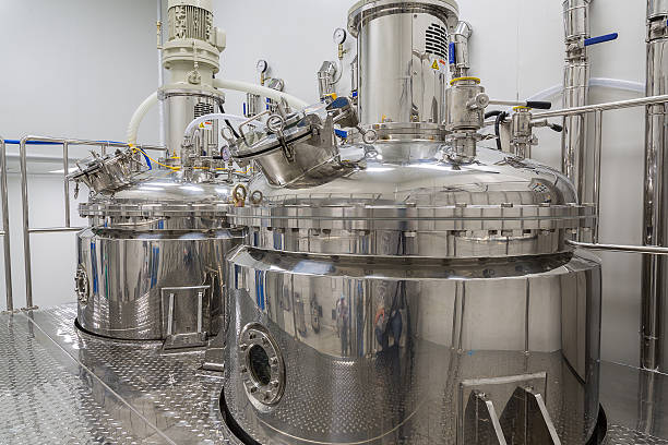 clean room with stainless steel hardware plant picture, clean room equipment and stainless steel machinesplant picture, clean room equipment and stainless steel machines chemical plant stock pictures, royalty-free photos & images