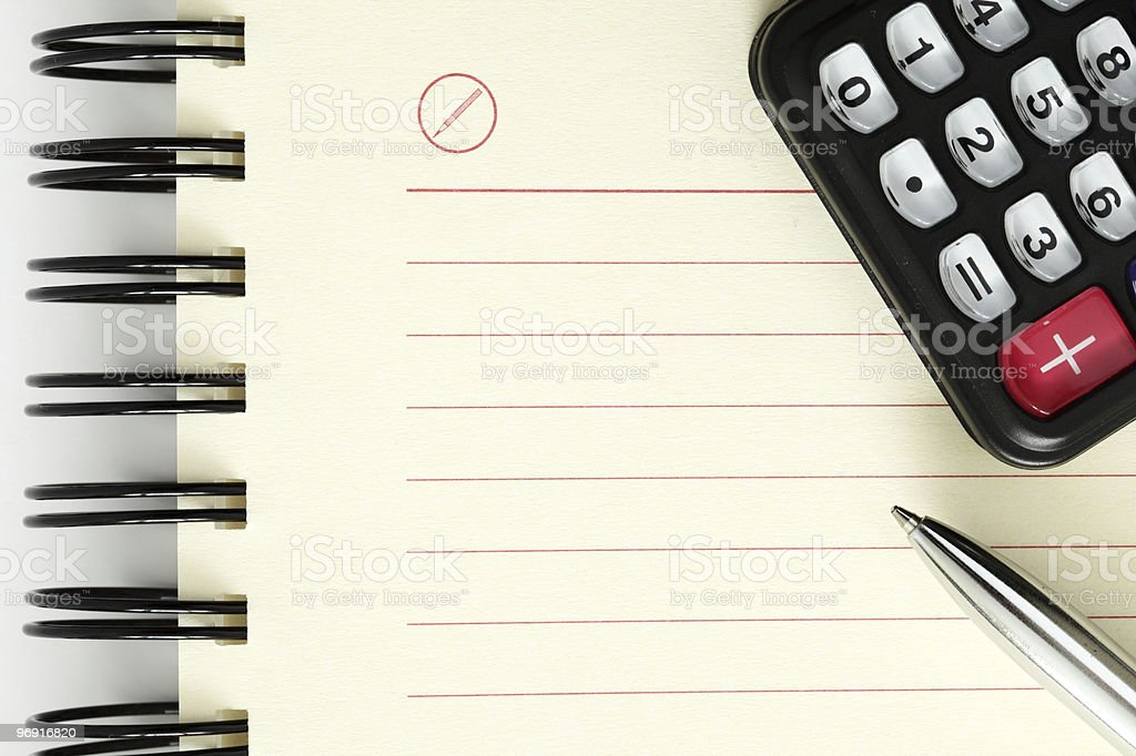 Clean sheet of notebook with pen and calculator royalty-free stock photo