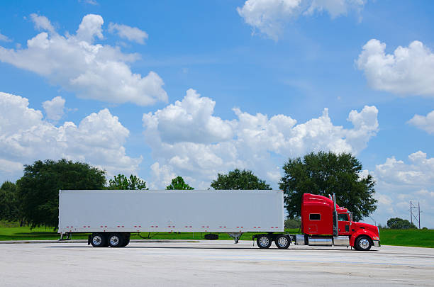 clean shiny red semi tractor truck w cargo trailer - side view stock photos and pictures