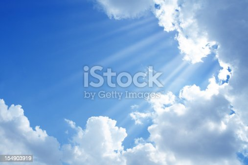 cloudy sky and sunbeam over blue sky.