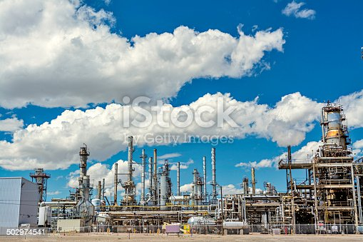 Oil refinery and blue sky with clouds