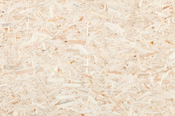 Clean surface of wood particle Board. Texture of compressed wood chippings board. stock photo