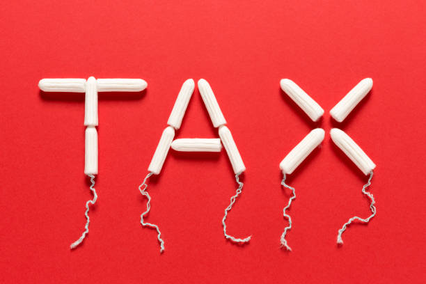 Clean Tampons Forming the Word TAX on a Red Background Clean tampons forming the word TAX on a red background tampon stock pictures, royalty-free photos & images