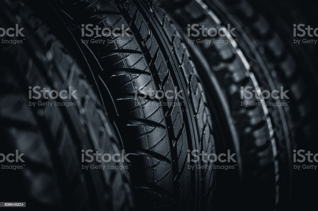 Clean Tyre, black new shiny car tire background stock photo