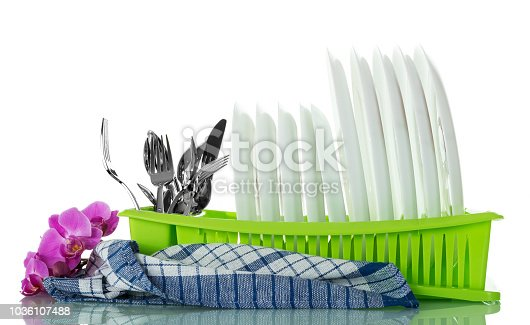 Clean washed kitchen utensils in drying isolated on white