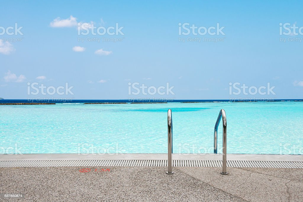 clean water in blue sky from shore stock photo