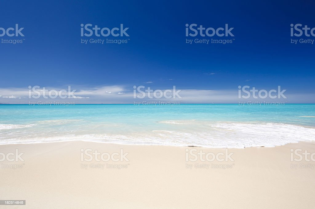 Clean White Caribbean Beach With Blue Sky stock photo