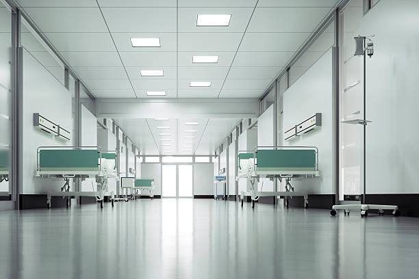 Clean white corridor in a hospital with stretchers stock photo