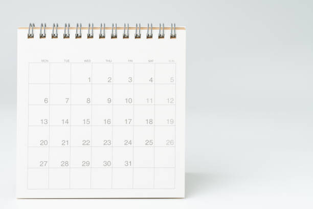 Clean white desktop calendar on white table with copy space, using for schedule appointment or year plan concept Clean white desktop calendar on white table with copy space, using for schedule appointment or year plan concept. month stock pictures, royalty-free photos & images