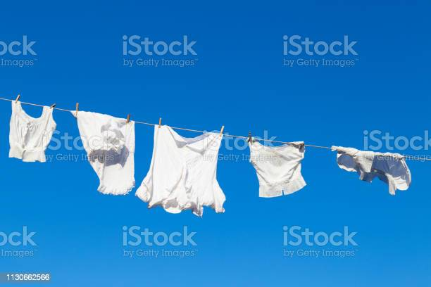 Clean white laundry drying in the sun picture id1130662566?b=1&k=6&m=1130662566&s=612x612&h=eucon9a23nsiqneh00 0 pu2xcmx7dukgmrvgtphu9o=