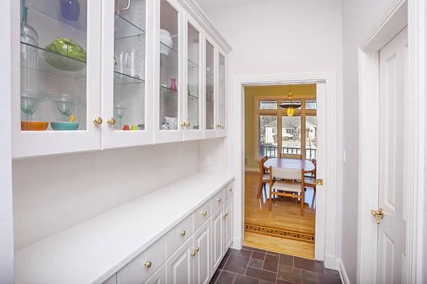 clean white pantry adjoining dining room. - vitrinenschrank stock-fotos und bilder