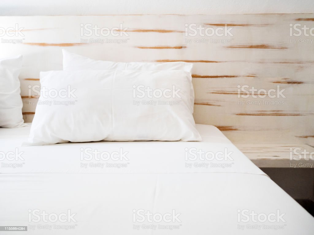 modern interior bedroom and white pillows