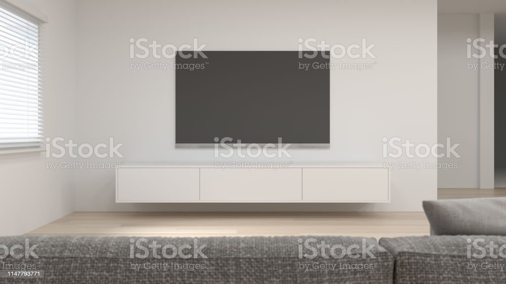 Clean white room and modern wood cabinet and TV in empty room...