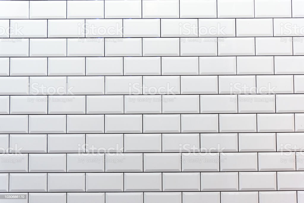 Clean white tiled wall stock photo