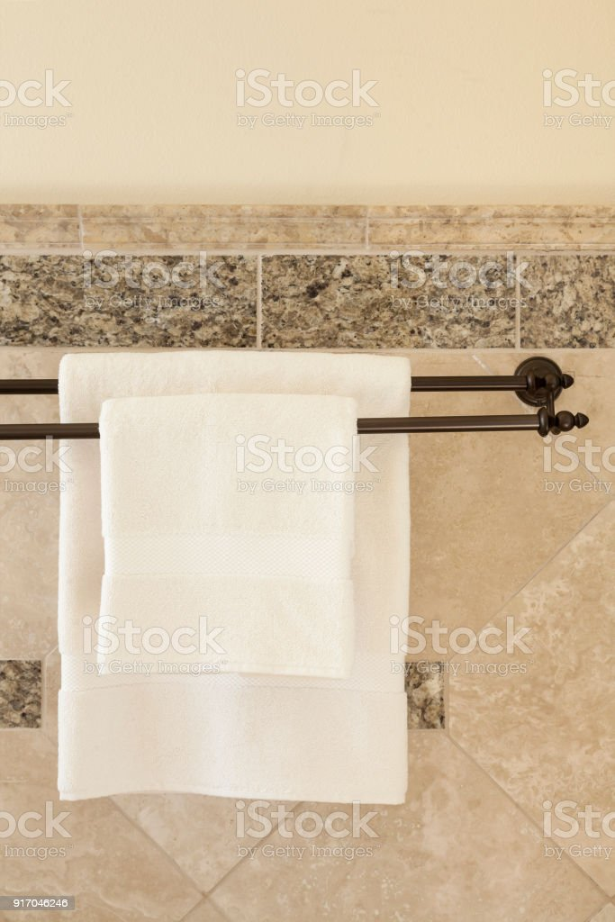hanging white towel. Clean White Towels Hanging On Bronze Towel Bars In High Quality Luxury Upscale Home Spa Bathroom