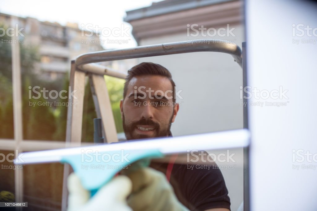 Clean window used as mirror by a window washer stock photo