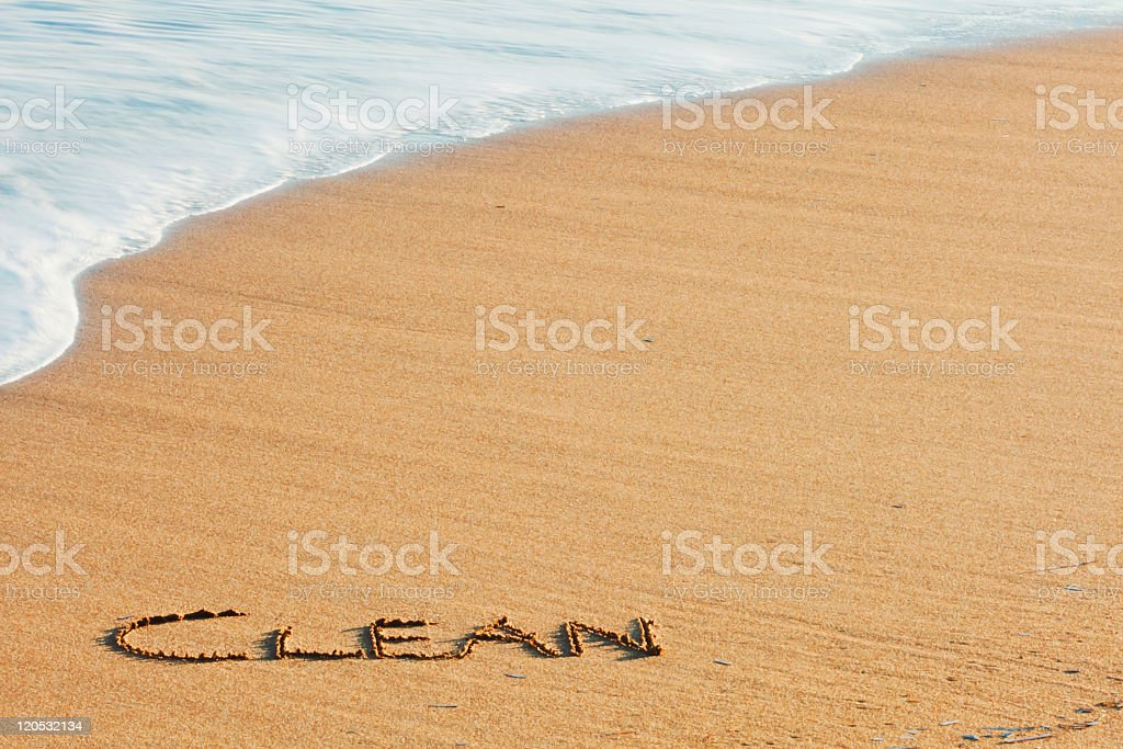 Clean written on sand of clean beach stock photo