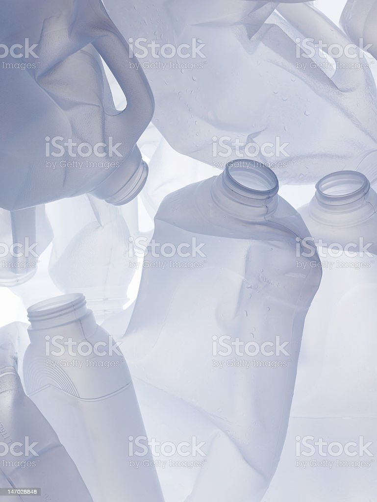 Cleaned discarded plastic milk bottles stock photo