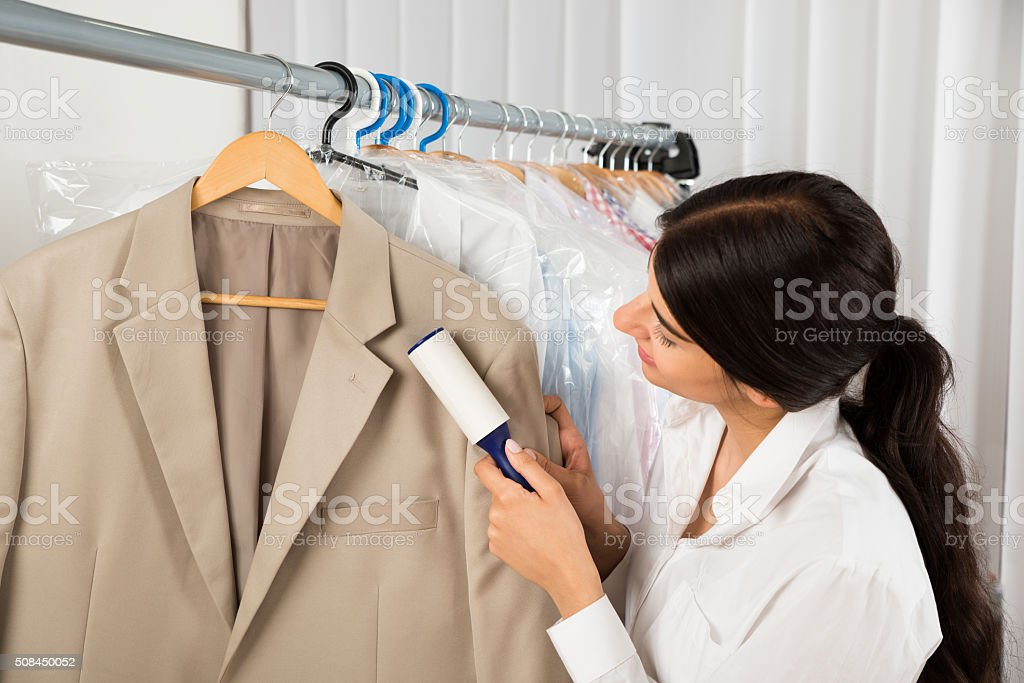Cleaner In Laundry Shop With Adhesive Roller stock photo