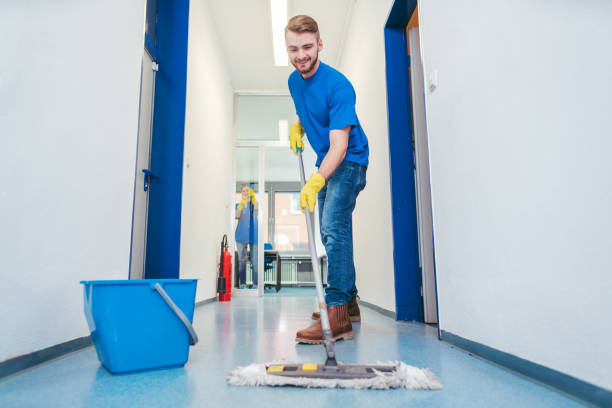 Cleaner man mopping the floor in a hall stock photo