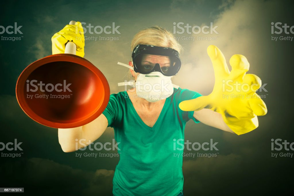 cleaner with plunger going crazy stock photo