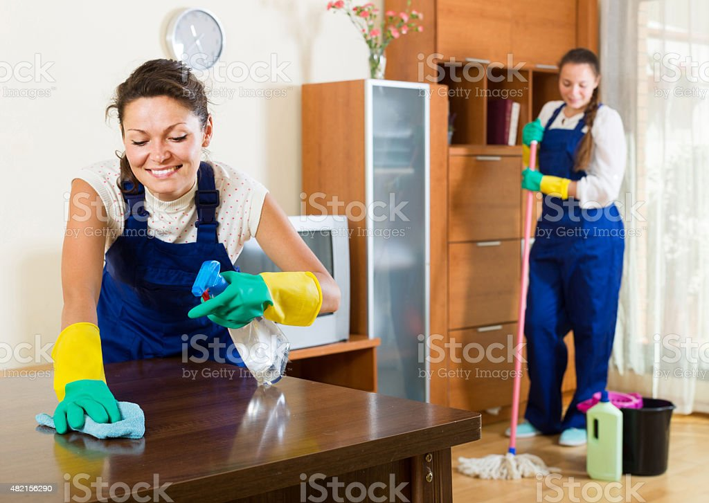 cleaners cleaning in room stock photo