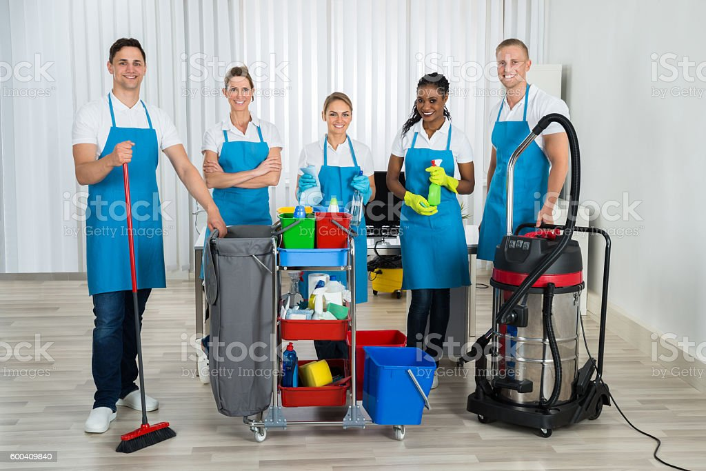 Cleaners With Cleaning Equipments In Office stock photo
