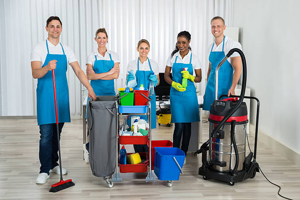 Cleaners With Cleaning Equipments In Office - Photo