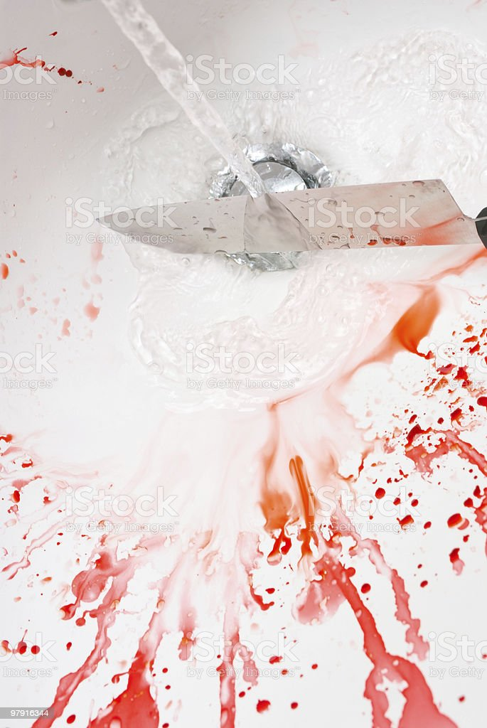 Cleaning a bloody knife royalty-free stock photo