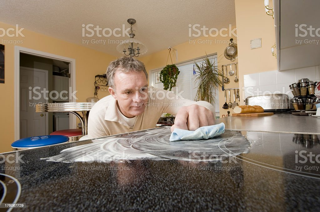 Cleaning a Ceramic Stovetop. royalty-free stock photo