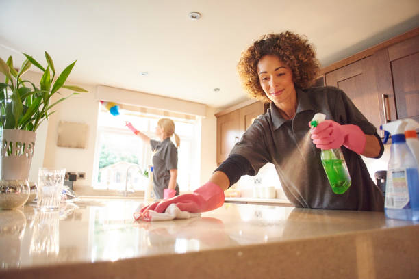 cleaning a marble worktop - maid stock pictures, royalty-free photos & images