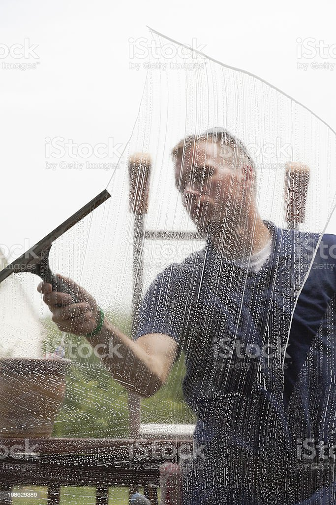 Cleaning a Window royalty-free stock photo