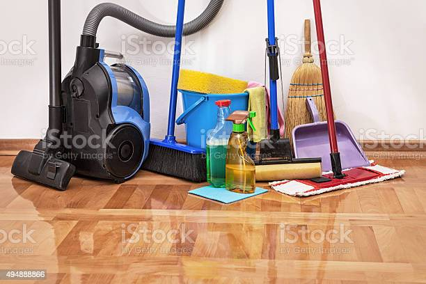 Cleaning Accessories On Floor Room Stock Photo - Download Image Now